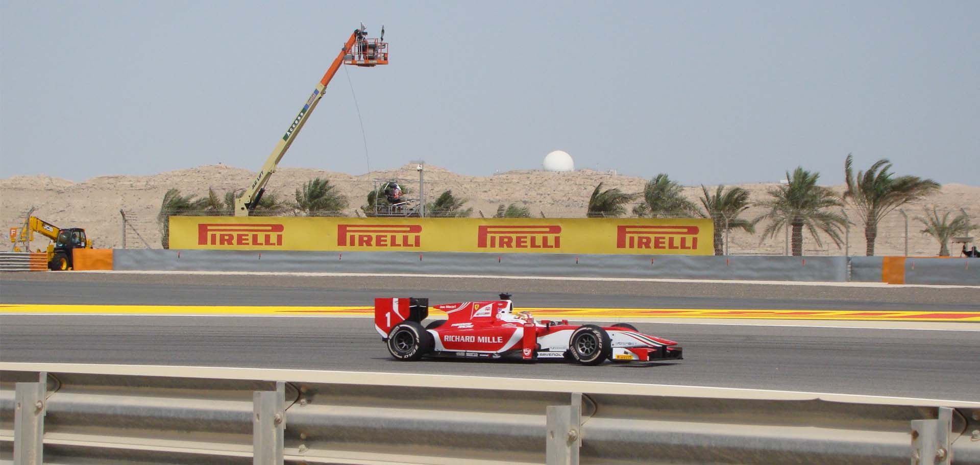 Rental Gulf MEWP over a race track